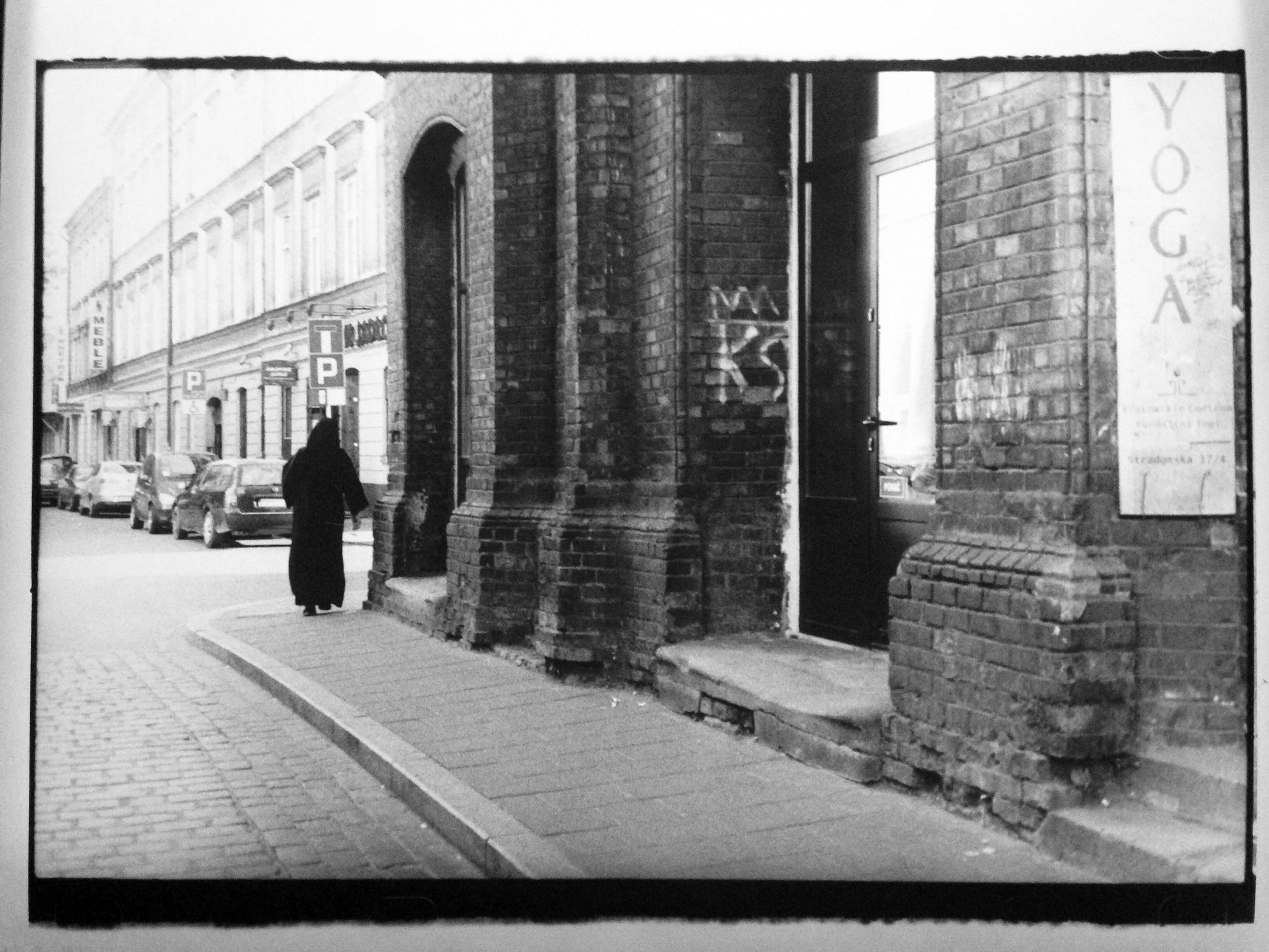 A priest walking in Krakow
